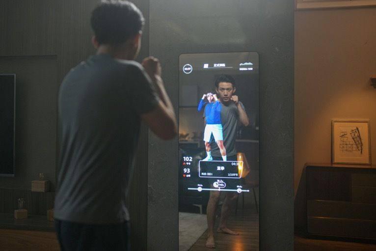 手机业务因制裁遇挫的华为,要靠智能健身镜来逆转小米OV?